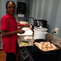 Donna cooking fried chicken for WU class