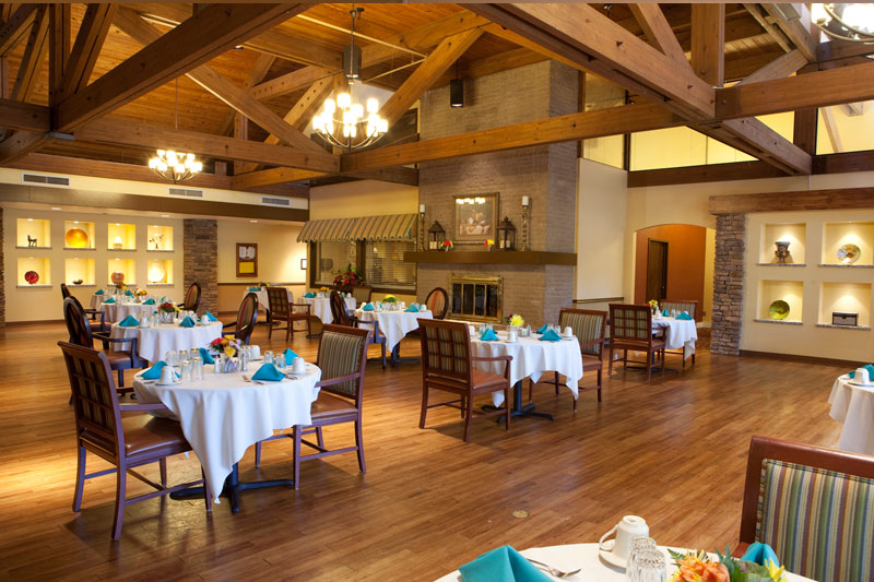 Large dining room with high ceilings, wood beams and floors