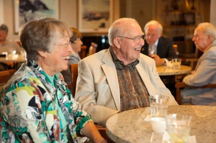 seniors enjoying dinner and cocktails with friends