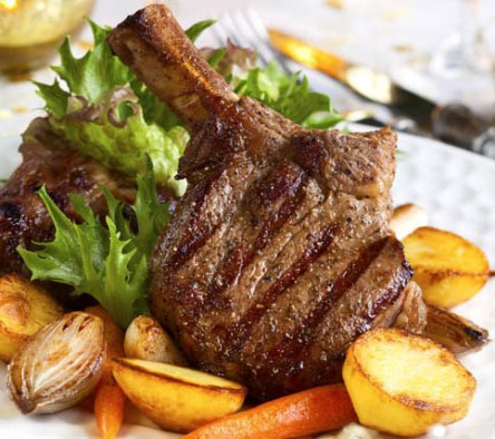 delicious chef prepared veal chops with vegetables