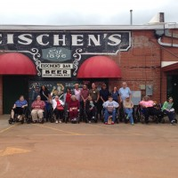 Eischens in front of sign do first