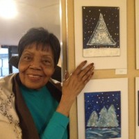 art show with resident by paintings