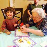 Easter egg hunt with sue and boy decorating cookies