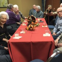 autumn-theme-party-with-group-at-table-margo-and-dahlgren