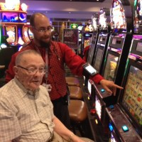 newcastle-casino-with-man-and-employee