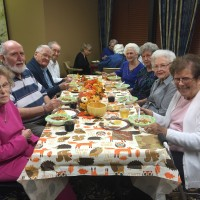 mens-group-chili-supper-2016-table-of-smiling-residents