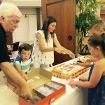 Family serving the Birthday Cake... kids in line first of course!