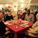 Darline and family having fun visiting during the Mexican dinner.