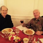 Dr. John Carey and Wally Brown toasting the occasion.