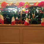Mexican flags and bright flowers in the dining room.