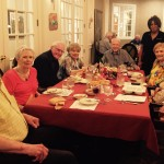 Our Cottage residents like sitting together at our monthly themed dinners!