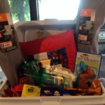 Ice chest with picnic items and fun chairs.