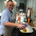 Shana Brown, LPN, cooking the omelettes.