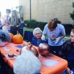Barbara Brewer and Heidi decided to decorate a big bronze pumpkin with black glitter and a small purple pumpkin with the words