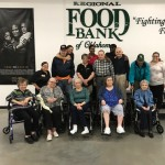 Group in front of the Food Bank sign.