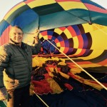 Eddie holding one side of the balloon as they attached it to the basket...showing the massive size of the balloon.