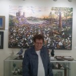 Mable in the room with artwork of pigeons painted by various artists.