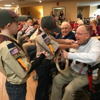 Veterans Day 2017 bill rodgers getting pins from boy scouts good pic