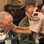 Warren receives his pin from the Boy Scouts.