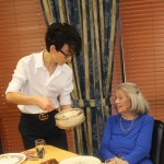 Marco serving mashed potatoes to Margaret.