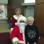 Anne sitting on Santa's lap and Mrs. Claus doesn't look too happy about that!
