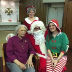 Darline with Santa, Mrs. Claus and Kaitlan the Elf at the Town Center party.