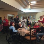 The singers at The Inn with Santa and Mrs. Claus.