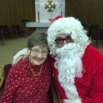 Jane and Santa cuddling at the Town Center party.