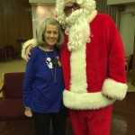 Margaret says this is her 15th photo with Santa here on Christmas.
