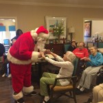 Santa at The Gardens wishing our memory care residents a Merry Christmas.