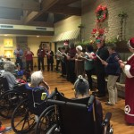 The group singing Christmas Carols at The Springs.