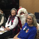 Barbara and Margaret all smiles with Santa at the Town Center.