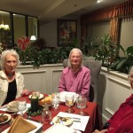 Betty, Joan, and Darline enjoying the Christmas meal.