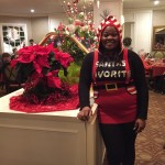 Shaunta, wait staff in the Town Center, dressed up as Santa's favorite elf!