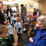 Kids visiting with Inn residents