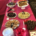 Food table full of chocolate desserts.