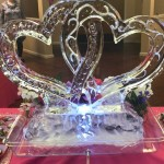 Beautiful ice sculpture adorns the head food table.