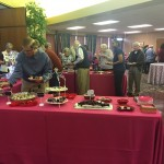 Guests gathered around the food tables.