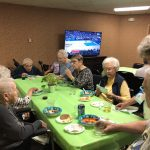 Residents on the TV side watching the basketball game and filling up on chili.