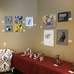 Wall of art from all levels of care, ceramics and quilt