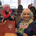 Coeata and Jane in their beautiful leis and photo props.