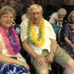 The Morrows and Margaret with colorful leis.