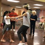 Chelsea demonstrating with Chloe (Heritage Hall Adopt a Grandparent student, how to turn your partner under your arm.