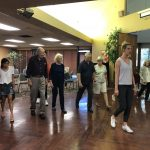 Chelsea showing the residents different types of steps in ballroom dancing.