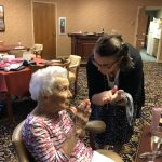Kelsey is doing the sugar scrub and hand cream on Barbara.