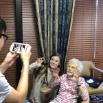 Barbara and her granddaughter both did face masks at the same time waiting for them to work as Marco takes photos.
